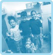 three friendly kids smiling